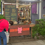 Getting a pulled pork sandwich at a food cart in Portland