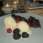 Home-made icecream with chocolate cake and fresh berries